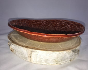 Dark red dish, textured dish, Textured dark red dish