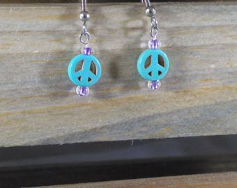 Small peace sign eating with purple accent beads