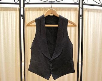 Men's antique formal vest, Edwardian waistcoat, 1910's, black synthetic jacquard, cotton back with adjustable belt, size small 34-35.