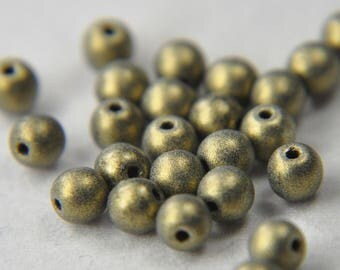 Czech pressed glass round druk beads 4mm sueded garnet  gold 100 beads