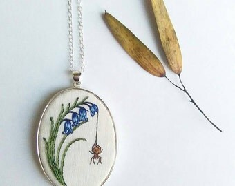 Hand embroidered bluebell with spider sterling silver pendant