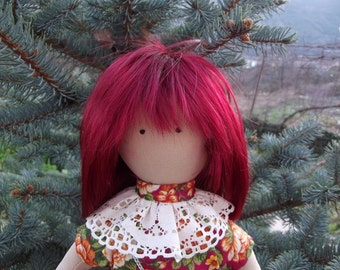 Stephanie. Pretty doll with red hair.