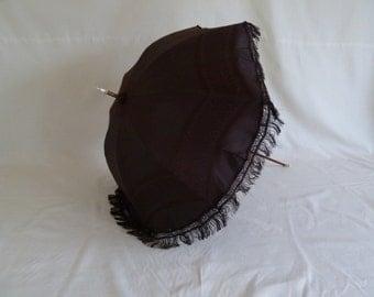 Beautiful condition genuine antique Victorian c1850 black silk parasol. Steampunk or Gothic umbrella with original cover and fringing.