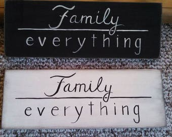 Family over everything, hand painted on wood. Family first
