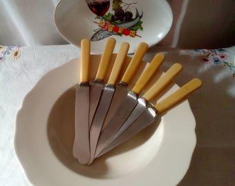A set of vintage Walker & Hall ivorine handled table knives