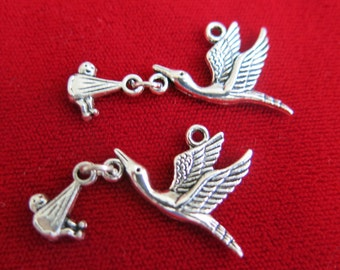 "BULK! 10pc ""stork with baby"" charms in antique silver style (BC129B)"
