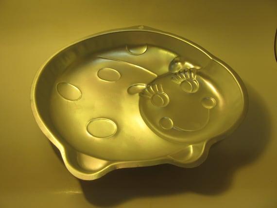 wilton ladybug cake pan instructions