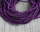 2-3mm Eggplant Purple Coconut Shell Pucalet Rondelle Beads Dyed and Waxed 15 inch strand