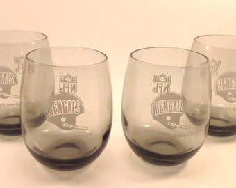 Set of 4 vintage Cincinnati Bengals NFL football sports team logos in white on smoke gray roly poly bar beverages glasses