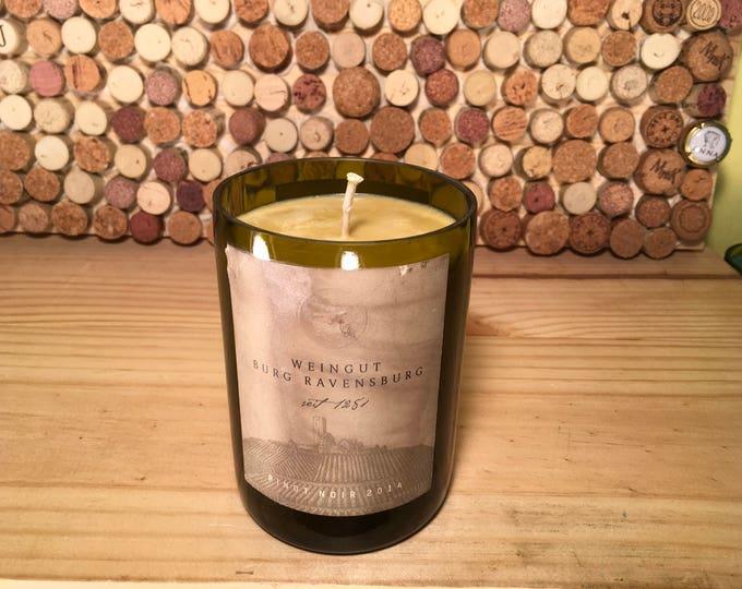 Weingut Burg Ravensburg Pinot Noir bottle with an Indian Sandlawood Soy candle