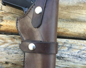 1911 holster, leather with pigskin lining, fully sewn, fits full size 1911 pistols . Handmade in Wyoming .
