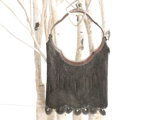 Antique chain mail purse with silver plated handle and frame, metal tassels on one side, scalloped bottom feature, Edwardian, 1900s