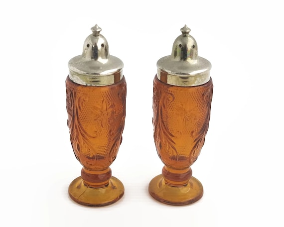 Amber glass and silver metal salt and pepper shakers, lovely pressed pattern on glass, small shakers, circa 1970s