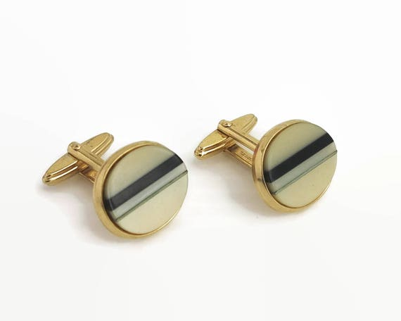 Pearly cream Lucite cuff links with silver and black Lucite stripes, gold tone metal setting, made in West Germany, circa 1960s