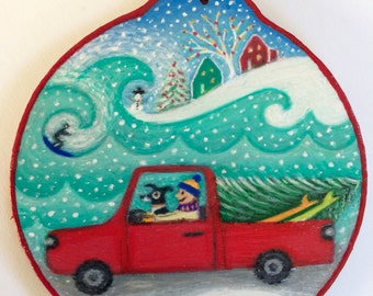 Surfer with Christmas tree ornament