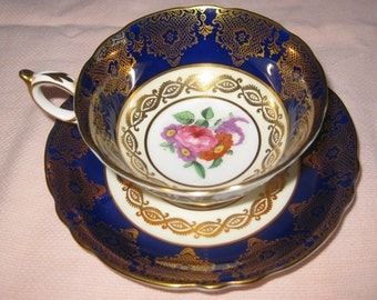 PARAGON fine bone china cup and saucer.  Cobalt, gold, flowers. Made in England