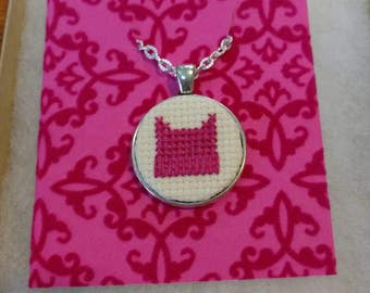 Pussy Hat cross stitch necklace in silver pendant. 10% goes to the ACLU because we're going to need them.