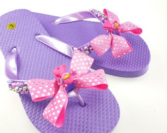 Girl's pink and purple kitty flip flops