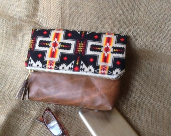 Southwest style Leather and fabric Clutch - brown leather with black, tan and red southwest fabric plus leather tassel