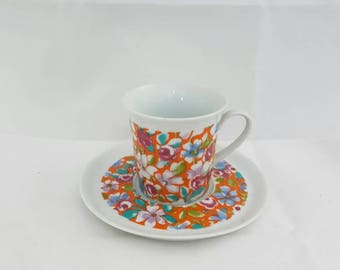 Glittered brightly coloured Cup and saucer set vintage floral motif. Missing Cup of