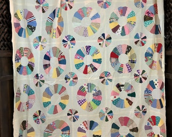 Large quilt top on beige background