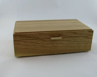 Tea box in Cherry on the side 12 X 6 3/4 x 3 3/4.Top is made from Cherry with vertical grain
