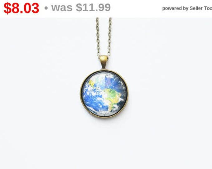 The SPACE Round pendant with the image of the planet Earth from brass and glass retro and vintage