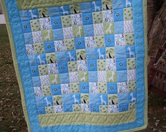 Hand quilted and hand made flannel quilt for baby boy.