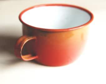 Vintage orange colour enamelled metal cup faded, vintage enamel mug