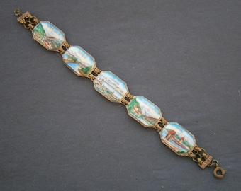 B955)  A lovely vintage copper tone metal painted enamel Swiss Switzerland landscape panel souvenir bracelet