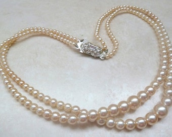 Vintage Double Stranded Faux Pearl  Necklace With Ornate Clasp.