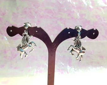Unicorns earrings on small clips.