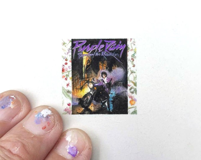 "Print of miniature painting of the Purple Rain Album.  1 1/4 x 1 1/4"" print of original Prince painting on 5"" square german etching paper"