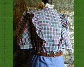 """1980's Blue, red, green & white plaid blouse with white eyelet, puffed sleeve.  Double ruffles, high neck  Bust 38""""  By Eber"""