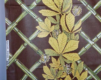 Elvira Urcola brown polished cotton with mustard yellow and green leaf columns and bamboo background grid