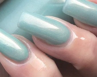 Lucky Shot sea foam green with gold shimmer nail polish