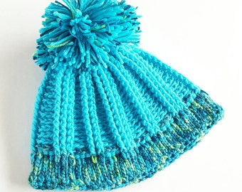 Pompom ribbed crochet hat in teals