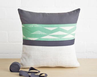 Throw pillow cushion cover in chalky white, pastel mint green and slate gray grey. Organic cotton print.