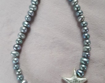 Gray beads with Silver Star