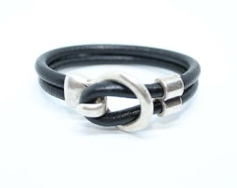 Women s black leather bracelet with hook-around clasp closure