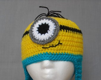 crocheted one eyed minion hat with earflaps and braided tassels