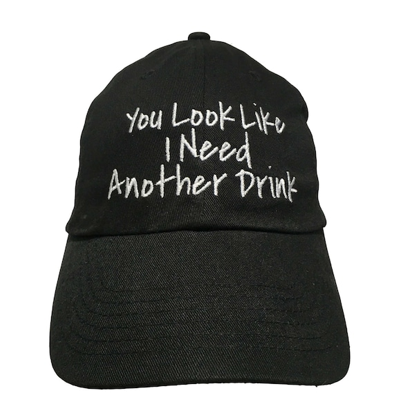 You Look Like I Need Another Drink (Polo Style Ball Cap - Black with White Stitching