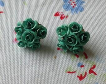 Turquoise metal rose earrings.
