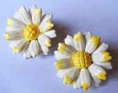 1950s Jewelry Styles and History Vintage Celluloid Daisy Earrings White  Yellow Handpainted Daisy Flower Plastic Clip On Earrings Estate Jewelry Floral Jewelry 1950s $37.00 AT vintagedancer.com
