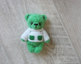 Crocheted bear, Mr. Green, knitting by a hook of a bear of Teddy