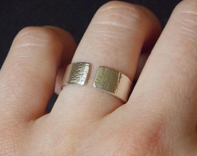 half open silver ring.