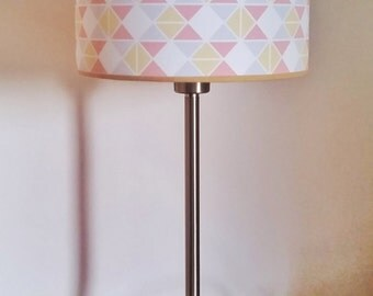 "Pastel cylindrical lampshade, geometrical pattern with triangles. 20x15cm (approx 8""x6""). Pink, yellow and blue."