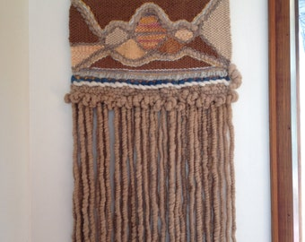 Hand woven hand made wall tapestry in soft natural colours
