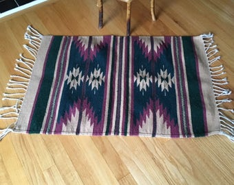 Vintage Southwestern/native hand woven wool rug/tassels/forest green/tan and violet