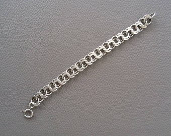 A silver 835 stamped 7 inch (18 cm) chain link bracelet, marked 835